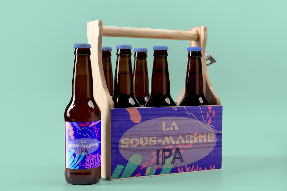 IPA beer bottle set box submarine with an illutrated label showing a shark fish seeweeds and corals